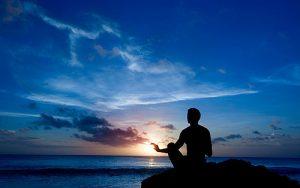 praying-on-ocean-cliff